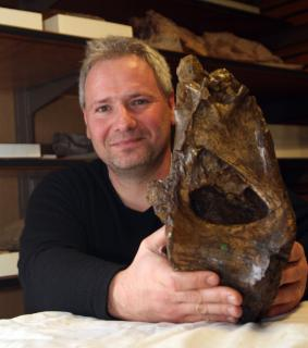 Me with the holotype dorsal vertebra of Xenoposeidon
